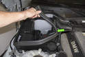 To replace the cylinder head coolant pipe, start by removing the E-box seal from the right side engine compartment.