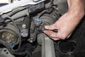 High beam bulb: Next, rotate headlight bulb holder counterclockwise and remove from headlight assembly.