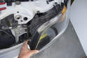 Then, remove the headlight assembly from the vehicle by pulling straight out toward front of vehicle.