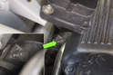 Working in engine bay, locate top of motor mount.