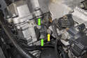 Working at front of the cylinder head, remove one 11mm fasteners (yellow arrow) and two 13mm fasteners (green arrows).
