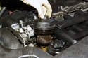 Models with 6-cylinder engine - Remove oil filter cover from engine and remove old oil filter from cover.