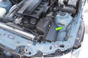 Models with 6-cylinder engine - The 6-cylinder engine air filter housing is located in the left side of the engine compartment (green arrow).
