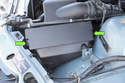 Models with 6-cylinder engine - Press the air filter lid retaining tabs in to release (green arrows).