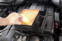 Models with 6-cylinder engine - Remove air filter from lid, install new filter and reinstall lid.