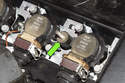Models with 6-cylinder engine -With cover removed, inspect mounting insulators, there are two and only used on cylinder head engine cover (green arrows).