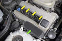 BMW Z3 models with a 4-cylinder engine utilize one ignition coil (green arrow) with an individual ignition wire running to each spark plug (yellow arrows).