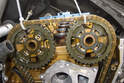 Lift camshaft timing chain with sprockets onto camshafts.