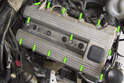 Models with 4-cylinder engine - Remove fifteen 10mm valve cover fasteners (green arrows).