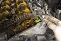 Models with 4-cylinder engine - Once clean, apply a small amount of RTV sealant to the timing cover to cylinder head joining area (green arrow).