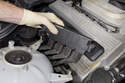 Models with 4-cylinder engine - Lift the ignition coil up and off the mounting bracket and lay aside.