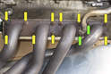 Models with 4-cylinder engine - This photo shows a better view of the secondary air pipe nuts (green arrows) and the exhaust manifold nuts (yellow arrows).