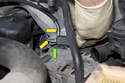 Models with 4-cylinder engine - Secondary air pump solenoid - The green arrow points to the plastic tab you unclipped in the previous step.