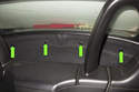 Working in passenger cabin behind seats at convertible top compartment, locate the trim panel clips (green arrows).