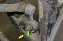 Start by loosening the sway bar end link bushing bolt (green arrow) loosen the 13mm nut while counter-holding the 13mm bolt.