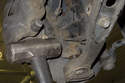 Using a ball joint separator, separate the ball joint from the steering knuckle.