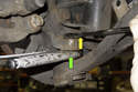 If the ball joint is spinning when you are trying to remove the nut, I use a thin jaw pair of vise grips (green arrow) to grab the ball joint shaft while loosening the nut (yellow arrow).