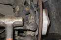 Use a ball joint separator to separate the tie rod end from the steering knuckle.