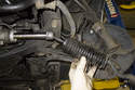 Slide the dust boot toward the outer tie rod end.