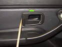 Then, using a plastic prying tool, lever the door handle trim piece in direction of green arrow.