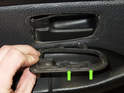 The green arrows point to the mounting tabs you have to disengage when you slide trim piece.