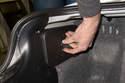 Working in trunk, rotate knob 90° counterclockwise to loosen.