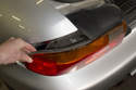 Then push tail light out of fender from inside trunk while supporting it from the outside.