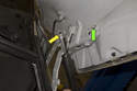Hood Support Struts-Pull support strut (yellow arrow) off stud (green arrow), then pull it off lower ball end and remove from vehicle.