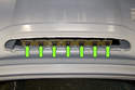 Once the cover is removed, there are seven separate bulbs for the third brake light (green arrows).