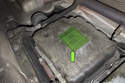This photo shows the sticker on the transmission pan that notes the fluid type and information (green arrow).