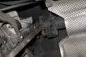 Using a pry bar or large flathead screwdriver, lever driveshaft away from transmission.