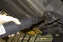 Pull the front section of driveshaft away from the rear section.