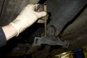 Once the snap ring has been removed, use a brass punch and drive the center bearing off of the driveshaft.