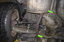 If replacing the left side drive axle, remove the rear section of exhaust (green arrows).