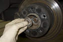 Once loose, remove the nut with the washer from the drive axle.