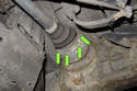 Next you have to loosen six axle mounting bolts (green arrows).
