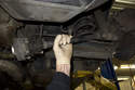 As you drive axle out of wheel hub, guide it down and remove it from the vehicle.