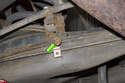 Working at back of trailing arm, remove the13mm sway bar bushing mounting bracket fastener (green arrow).