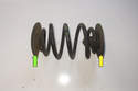 Inspect upper (yellow arrow) and lower (green arrow) spring pads for wear or damage.