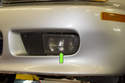 Fog Light-The fog light is located in the lower corner of the front bumper (green arrow).