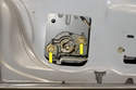 Remove the two 10mm trunk release button fasteners (yellow arrows).