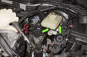 Using a 13mm socket on an extension, remove both brake master cylinder nuts (green arrows).