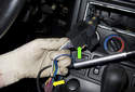 When installing an aftermarket radio, you will need an adapter for the electrical connector (green arrow) and the antenna.