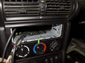 Before finalizing the wiring, install the radio mounting cage (green arrow) into the dashboard.