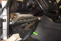 Pull knee bolster (green arrow) down and away from dashboard and remove.