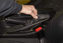 Working in the parking brake lever, pull the rear of the parking brake handle trim cover off.