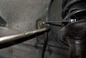 Loosen the steel line by counter-holding the brake hose, then loosening the line nut using an 11mm line wrench.