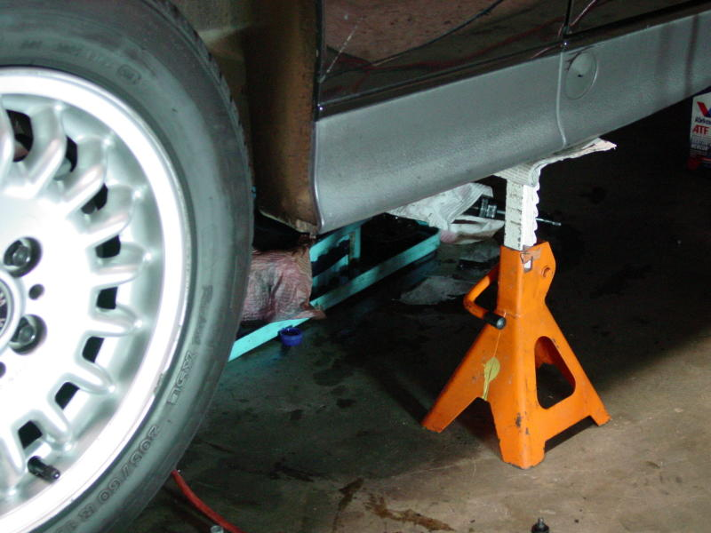Jack The Car Up And Put Stand Under Vehicle S Jacking Point Lower Remove Floor