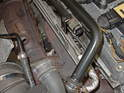 Here I've disconnected the hose (out of focus in the foreground) at the top, by the engine.
