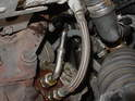 Pull the rubber hose off of the pipe that protrudes from the center section of the turbocharger.